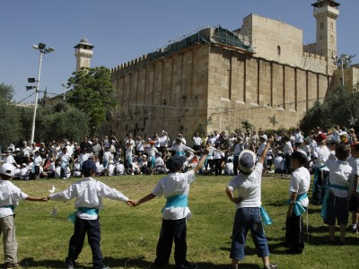 children celebrating the returning of Torah scrolls