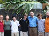 Students and staff gather outside Miami Country Day School's first-ever sukkah. Left to right: Tenth-grader Nicole Farchi-Segal; humanities teacher and club sponsor Allison Schwartzbaum; tenth-graders Simon Hoffman and Justin Golden; headmaster Dr. John Davies; tenth-grader Jordan Karp and world religion teacher Daniel Penengo.