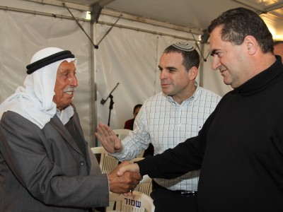 Ministry of Transport and Road Safety Israel Katz (R) attends an inauguration ceremony for a newly built square at the entrance to the Jewish Efrat settlement, together with Abu Taleb from the nearby Arab village.