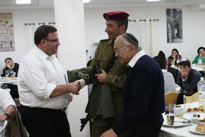 Meir Blisko, a guest at Yeshivat Shavei Chevron; Colonel Guy Hazut; and Minister of Justice Yaakov Neeman.