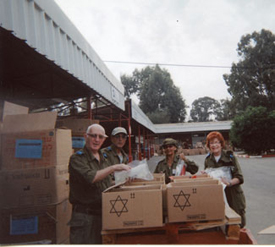 Gloria and Sar-El volunteers packing supplies.