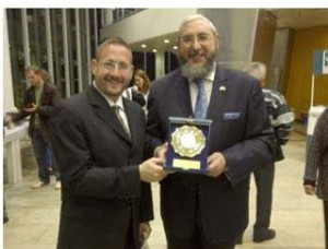 MK Rabbi Haim Amsalem (right) receiving the Quality Leadership Award for 2011, with Rabbi Dov Lipman.