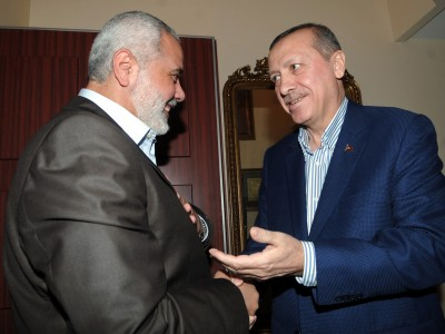 Hamas leader Ismail Haniyeh (L) and Turkish Prime Minister Recep Tayyip Erdogan shaking hands before their meeting at Erdogan's residence in Istanbul Turkey