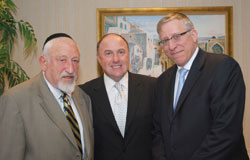 (L-R) Guest speaker Rabbi Dr. Joel Rosenshein; reception host Chaim Manela; and RCCS Executive Director Rabbi Yosef C. Golding. Photo credit: Arye D. Gordon