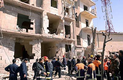 Rescue teams watching the ruins following a car blast in Aleppo.