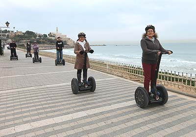 Tourists ride segways down the new promenade in Tel aviv.