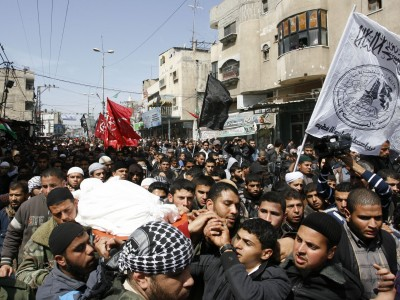 Palestinians carry the body of the Popular Resistance Committees leader Zuhair al-Qaisi during his funeral in the southern Gaza Strip