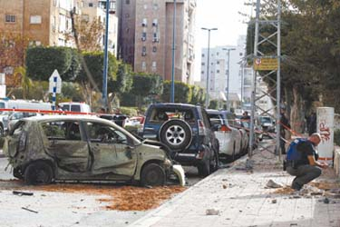 Aftermath of Grad rocket attack on center of southern Israeli city of Ashkelon.