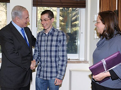 PM Netanyahu greeting Gilad Shalit as his mother Aviva looks on
