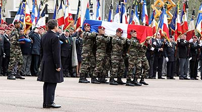 President Nicolas Sarkozy at the funeral of French paratroopers. The President granted a request for posthumous marriage by the girlfriend of one of the fallen.