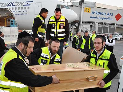 ZAKA volunteers loading the arriving victims at Ben Gurion airport Wednesday morning.