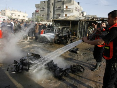 Palestinians extinguish a fire after an Israeli airstrike in Rafah