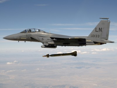 "An F-15E Strike Eagle releases a GBU-28 ""Bunker Buster"" 5,000-pound Laser-Guided Bomb"