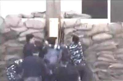 Hamas soldiers executing a man suspected of collaboration with Israel.