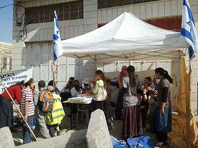 The evacuated residents of Machpelah House in Hebron have erected a protest tent in front of their empty property.