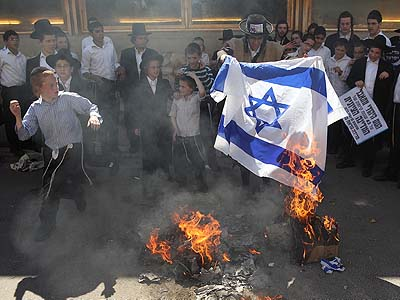 Members of Netorei Karta gathered last year to burn the national flag on Israel's Independence Day.