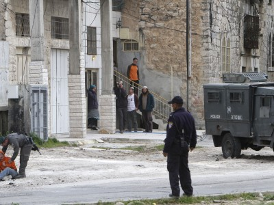 Israeli soldiers outside the house in Hebron that is subject to the eviction order