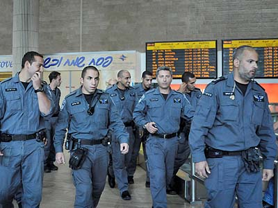 Israeli police wait inside the arrival terminal at Ben Gurion airport, April 15, 2012. Israeli authorities deployed hundreds of police at the airport, to stop foreign activists taking part in a 'Welcome to Palestine' fly-in.