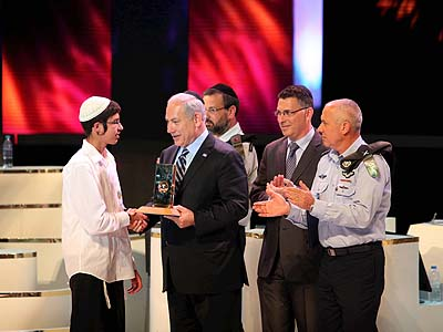 Elhanan Bloch winner of the annual Bible Quiz, receives his first prize from Israel's Prime Minister Benjamin Netanyahu, at the Jerusalem Theatre on Israel's Independence Day.