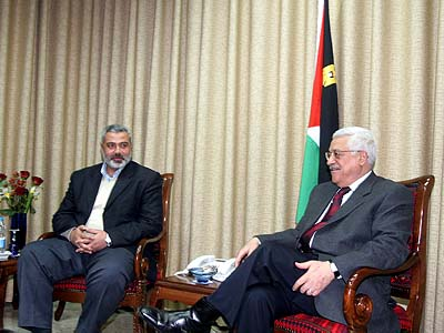 PA President Mahmoud Abbas meeting with Hamas leaders Ismail Haniyeh in February.