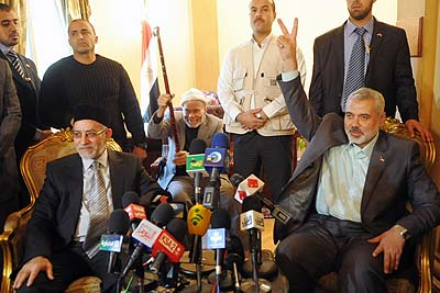 Egypt's Muslim Brotherhood leader Mohammed Badie (L) with senior Hamas leader Ismail Haniyeh. The nightmare of an Egypt dominated by the Brotherhood may become a come the May 23 Presidential elections.
