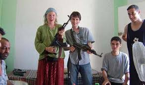 ISM activists pose with AK47s in Jericho alongside Al Aksa Martyrs Brigade terrorists.