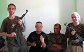 ISM activists posing with AK47s in Jericho alongside Al Aksa Martyrs Brigade terrorists