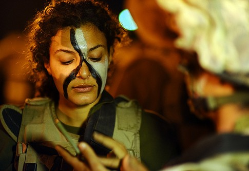 Israeli female combat soldier examining her makeup. Do male warrioers complain that it takes the lady combatants hours to get ready?
