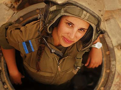Love a woman in uniform. A tank instructor during her training course surfaces for a second to say hello.