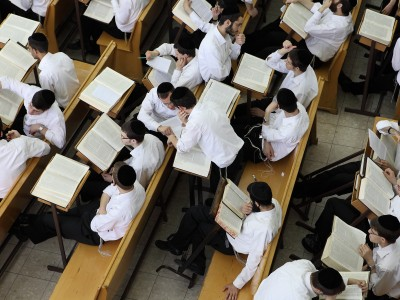 Jewish men studying at a yeshiva