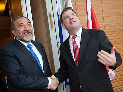 Canadian Minister of Foreign Affairs John Baird with Israel's Foreign Minister Avigdor Liberman.