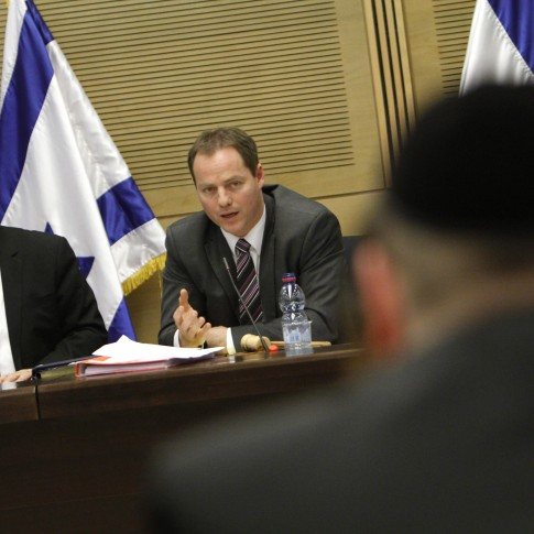 Kadima chairman Shaul Mofaz and Kadima MK Yochanan Plesner attend a discussion about the Tal Law