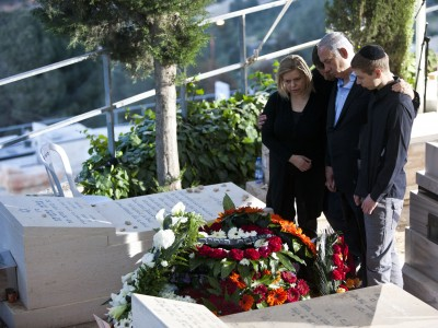 Israeli Prime Minister Benjamin Natanyahu, his wife Sara and sons Yair and Avner, attend the funeral of his father Benzion in Jerusalem.