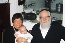 Rebbetzin Rivkah and Rav Akiva Hacarmi with a great-grandchild