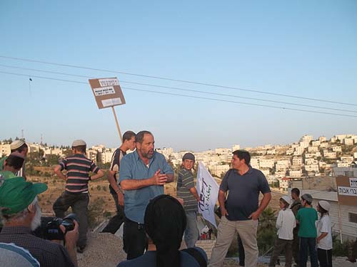 Noam Arnon, center, Spokesman for the Hebron Jewish residents, decried the blatant discrimination against Jewish construction in the city.
