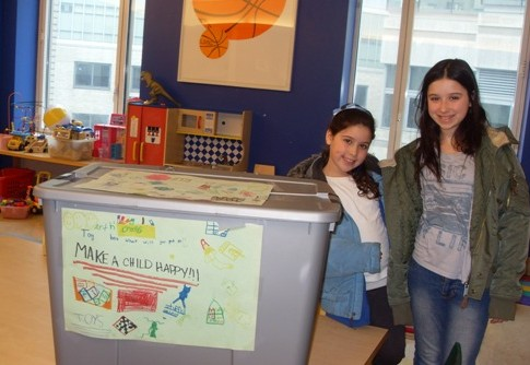 NY Hospital Cornell Bikur Cholim receives books and toys donated by Moriah Yeshiva of Englewood, NJ. Stefanie (L) and Julia Leavitt (R)