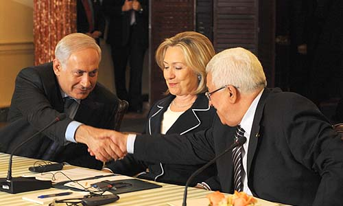 Playing nice: Prime Minister Netanyahu shaking hands with PA President Abbas, under the supervision of Secretary of State Clinton in Washington, DC, September 2010.