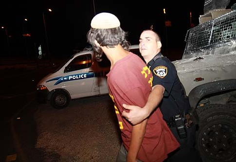 Border Guard arresting a Ramat Migron resident last week.