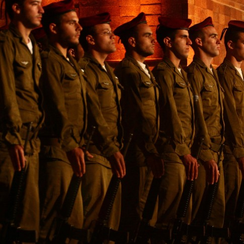Israeli soldiers stand at attention at the Yad Vashem Holocaust memorial in Jerusalem