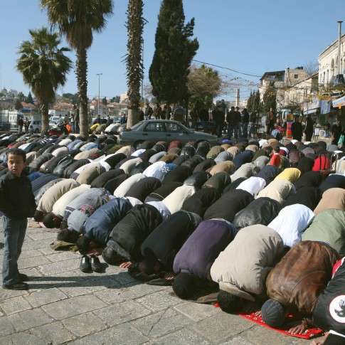 Muslims men praying at Damascus Gate