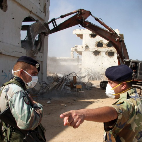 Lebanese soldiers oversee the removal of rubble from the Nahr el Bared Palestinian refugee camp.