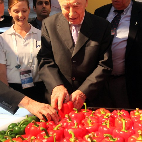 President Peres Examining the Peppers at the President's Conference