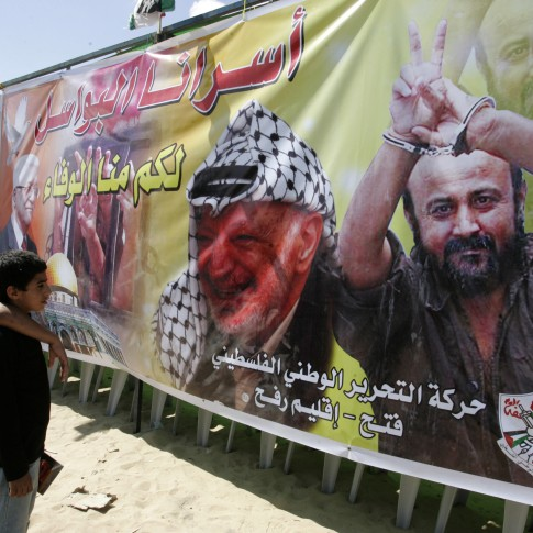 Arab children look at pictures of two of a kind - Arafat and Barghouti.