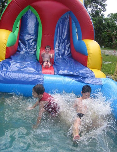 Neytz campers enjoy a slippery water slide.
