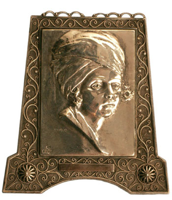 Tunisian Boy (late 1930s), silver cast plaque with filigree silver frame by Moshe Murro Collection of Ira and Brigitte Rezak