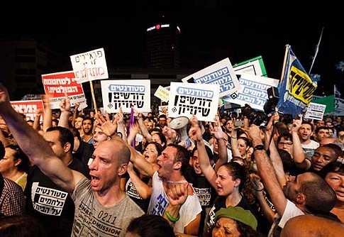 Some 35,000 people rallied in Tel Aviv urging government to enact universal draft legislation.