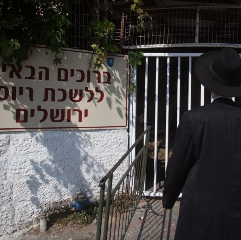 An ultra orthodox Jew is standing next to the army recruiting office in Jerusalem on July 08, 2012