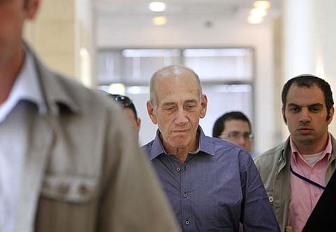 Former Prime Minister Ehud Olmert on his way to hear the court verdict on his corruption charges, July 10 2012.