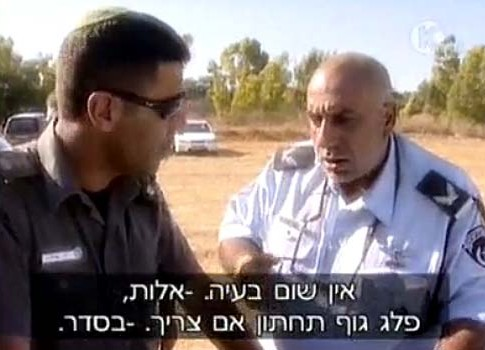 "The condemning video: then Police Commander Nisso Shacham instructing his men during a police siege on anti-evacuation marchers at Kfar Maimon. His gem in this frame: ""No problem whatsoever – batons, lower body if necessary. – OK."""