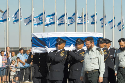 Coffin of former prime minister Yitzhak Shamir is carried from the Knesset to burial service on Mt. Herzl Monday evening.